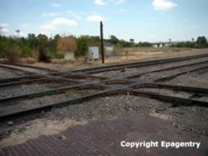 The crossing of the Cotton Belt and I&GN tracks in downtown Tyler, Texas
